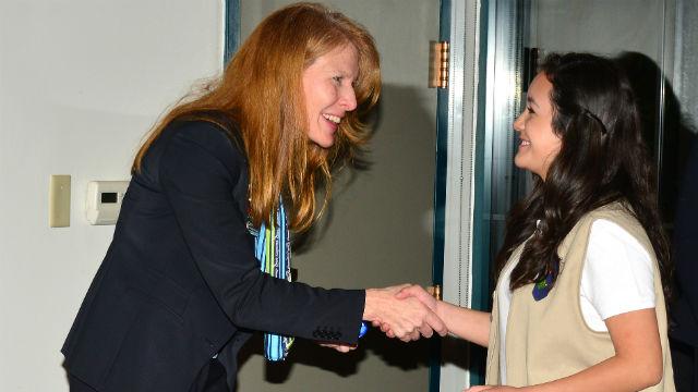 Carol Dedrich greets a Girl Scout.