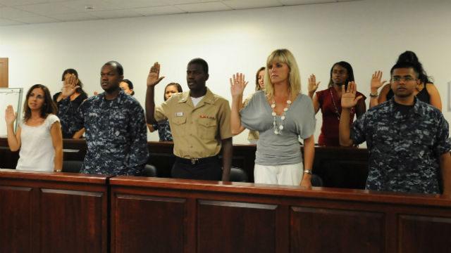 A citizenship ceremony at a Navy base on Sicily. Navy photo