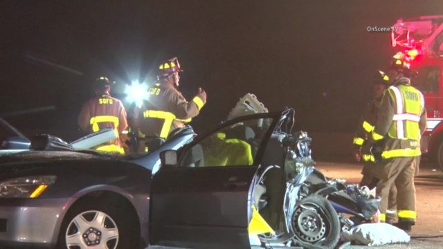 Firefighters examine the wreckage of the sedan on Interstate 15. Courtesy OnScene.TV