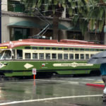 A vintage trolley in the rain in downtown San Diego