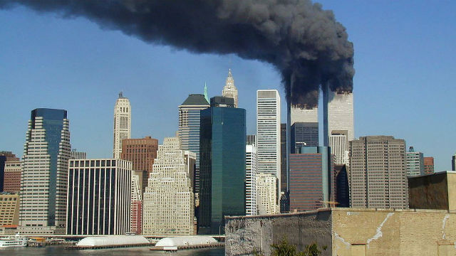 The twin towers burning during the Sept. 11, 2001, attack in New York. Photo by Michael Foran via Wikimedia Commons