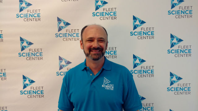 Fleet Science Center CEO Steve Synder with the new logo. Photo by Chris Jennewein