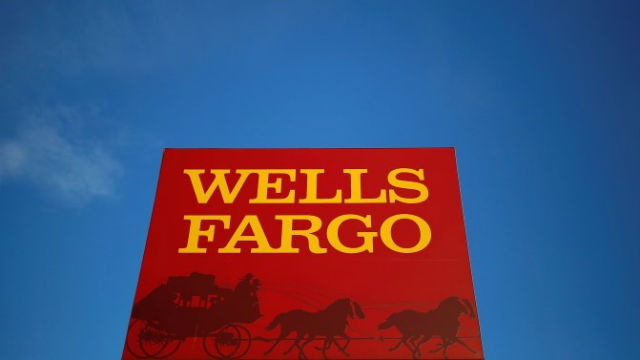 A sign outside a Wells Fargo branch. REUTERS/Jim Young