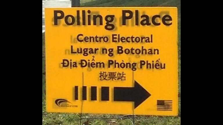 Poll sign in various languages. Image via County News Center