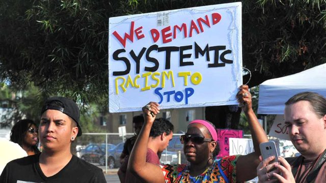 Protesters show demands near site of fatal police shooting in El Cajon. Photo by Chris Stone