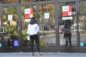 Shopper encounters locked Macy's story at shuttered Parkway Plaza mall in El Cajon. Photo by Chris Stone