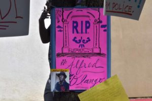 Protesters mark site of fatal police shooting in El Cajon. Photo by Chris Stone