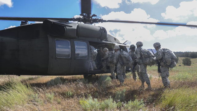 California National Guard troops board a helicopter