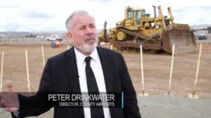 County Airports director Peter Drinkwater at Gillespie Field groundbreaking. Image via YouTube.com