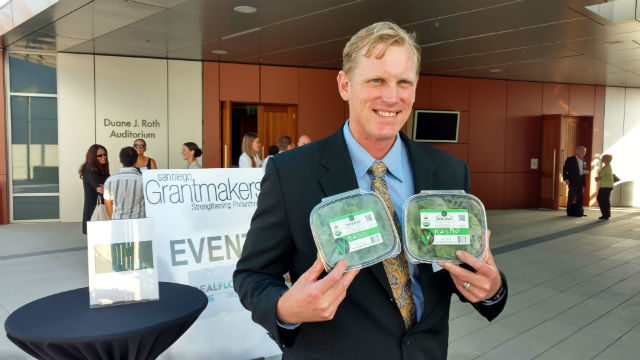 Archi's Acres CEO and co-founder Colin Archipley with packages of his organic basil. Photo by Chris Jennewein