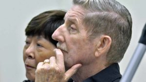 Calvin Gitsham and his wife, Grace, listen to their only child at Town Hall. Photo by Ken Stone