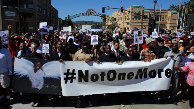 Demonstrators hold a march and rally to protest the fatal police shooting of Ugandan immigrant Alfred Olango in El Cajon REUTERS/Mike Blake