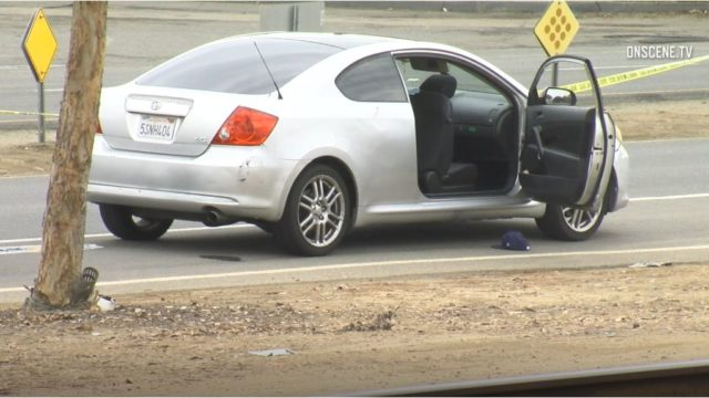 The carjacked vehicle at the scene of the shooting. Photo by OnScene.TV