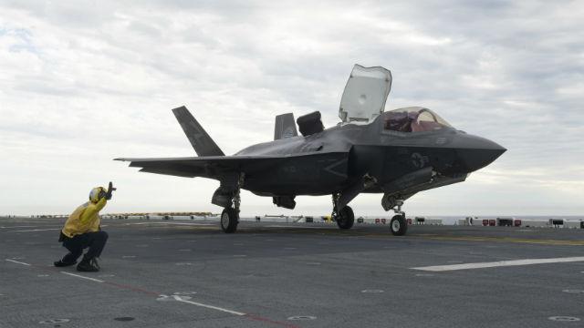 An F-35B prepares to launch from the flight desk of the USS America in the Pacific Ocean. Navy photo