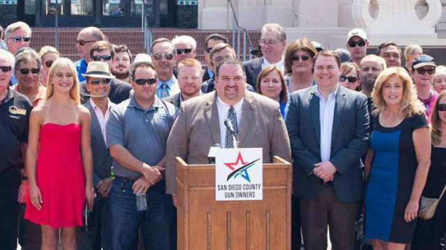 Michael Schwartz (center) at a press conference outside the county administration building.