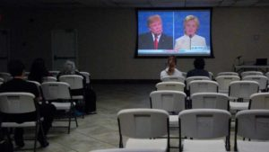 Seats were empty early in the debate at prayer time. About 50 people gathered afterward at the Islamic Center of San Diego. Photo by Chris Stone
