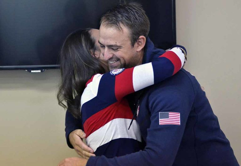 Caleb Paine and fellow Olympic sailor Briana Provancha hug after talking about growing up together and sharing the Olympics together. Photo by Chris Stone