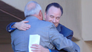 SDSU President Elliott Hirshman embraces Ron Fowler. Photo by Chris Jennewein