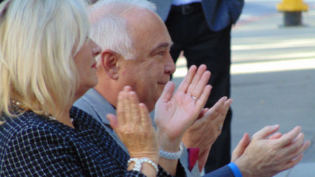 Ron and Alexis Fowler applaud during the ceremony at San Diego State University. Photo by Chris Jennewein