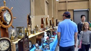 Shoppers check out collections at the Southwest California regional National Association of Watch & Clock Collectors convention at the Del Mar Fairgrounds. Photo by Chris Stone