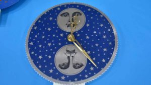 Nile Godfrey makes these clock faces that show when there is a full moon. Photo by Chris Stone