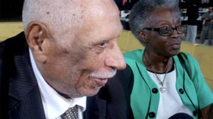 World War II veteran Silas Gross of San Diego and his daughter, Dorothy McCray, describe their brief visit with President Obama. Photo by Ken Stone
