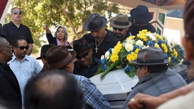 Casket with Chunky Sánchez is carried out after memorial service in Chicano Park. Photo by Chris Stone