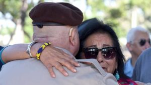 Deep emotions were shared at Chunky Sánchez memorial service in Chicano Park. Photo by Chris Stone