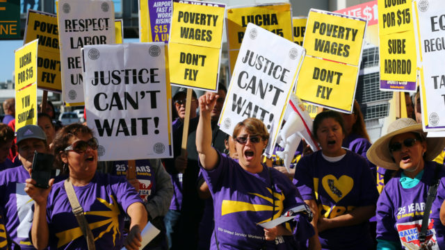 "Demonstrators participate in the ""Fight for $15"" wage protest at Lindbergh Field. REUTERS/Mike Blake"