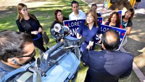 Univision crew interviews Rep. Loretta Sanchez after event in Chicano Park. Photo by Ken Stone