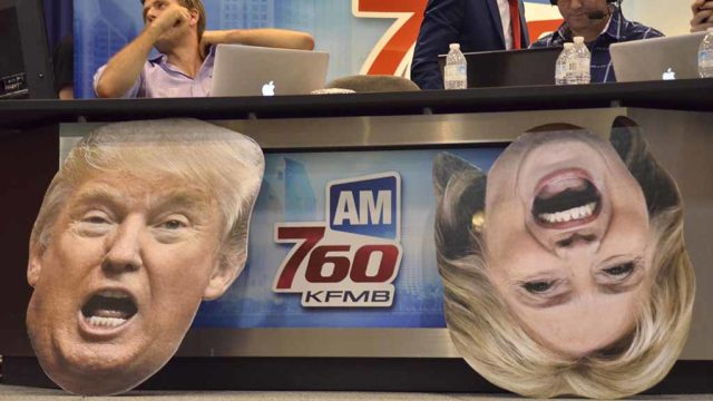 KFMB radio crew worked amid cutouts of the presidential rivals. Hillary Clinton's head rolled over. Photo by Chris Stone