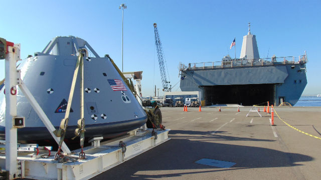 The Orion test vehicle with the open well desk of the USS San Diego visible in the background. Photo by Chris Jennewein