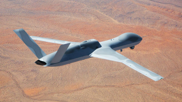 A Predator C Avenger in flight over the Southern California desert. Courtesy General Atomics