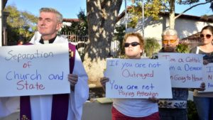 Protesters outside Immaculate Conception Catholic Church. Photo by Chris Stone