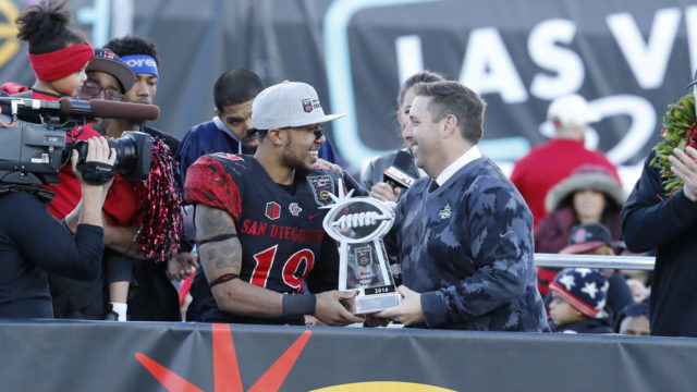 LAS VEGAS, NV - DECEMBER 17: San Diego State Aztecs (19) Donnel Pumphrey (RB) accepts the Most Valuable Player (MVP) award from John Saccenti after winning a NCAA football game against the University of Houston Cougars on December 17, 2016, at the Las Vegas Bowl in Las Vegas, Nevada. The San Diego State University Aztecs would defeat the University of Houston Cougars 34-10. (Photo by Marc Sanchez/Icon Sportswire)