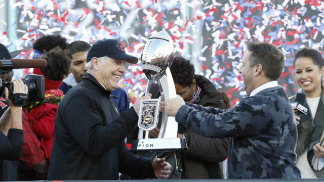 LAS VEGAS, NV - DECEMBER 17: San Diego State Aztecs head coach Rocky Long accepts the Las Vegas Bowl championship trophy from John Saccenti after winning a NCAA football game against the University of Houston Cougars on December 17, 2016, in Las Vegas, Nevada. The San Diego State University Aztecs would defeat the University of Houston Cougars 34-10. (Photo by Marc Sanchez/Icon Sportswire)
