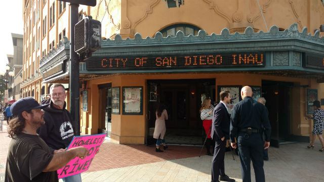 A few protesters gathered outside the Balboa Theater prior to the inauguration ceremony. Photo by Chris Jennewein