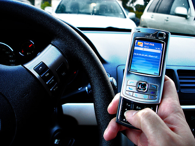 Texting while driving. Photo by Tim Caynes via Flickr