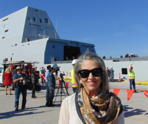 Ann Zumwalt with the new ship looming in the background.