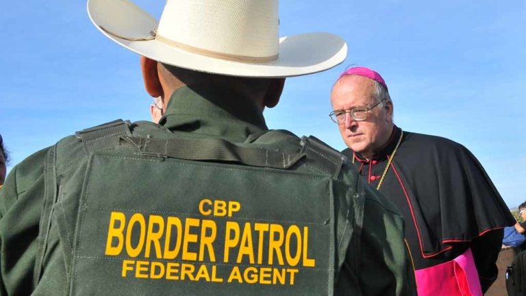 San Diego Bishop Robert McElroy listens to instructions by the Border Patrol before the event. Photo by Chris Stone