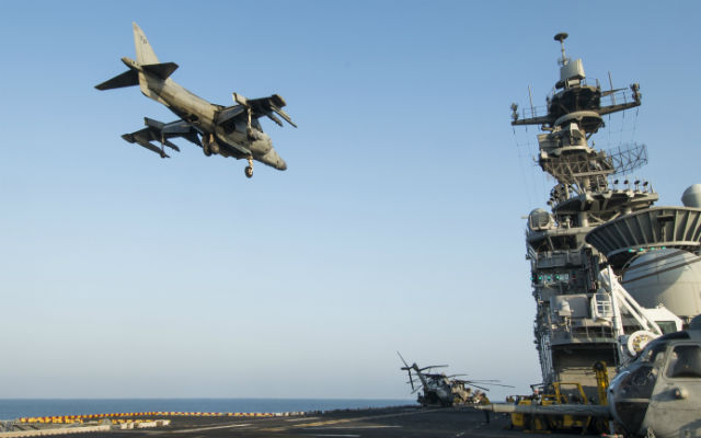 An AV8-B Harrier hovers above the flight deck of the USS Making Island in the Gulf of Aden on Wednesday.