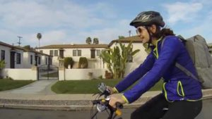 Nicole Capretz is shown biking to work at San Diego City Hall in 2014 video. Image via Vimeo.