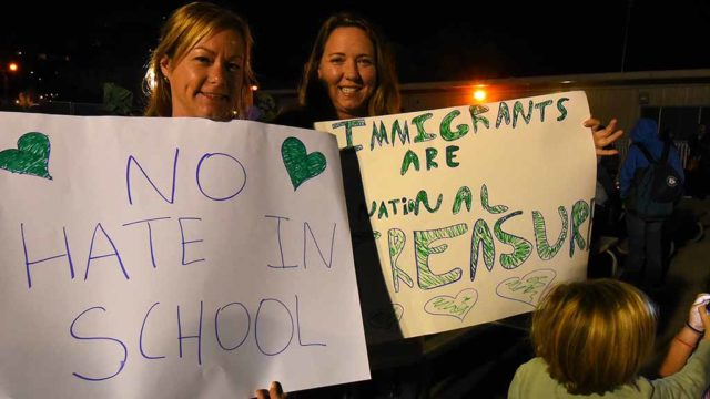 """Activist Moms"" Jen Gamez (left) and Dawn Hagan brought signs and five children between them. Photo by Ken Stone"