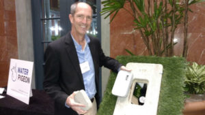 Water Pigeon co-founder Clay Melugin demonstrates his water monitoring product.