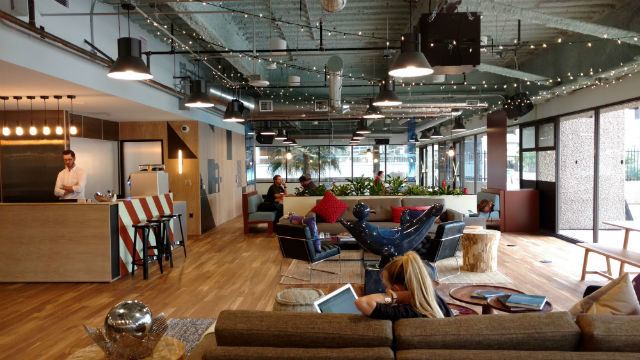 The kitchen and community area on one floor of the WeWork facility in downtown San Diego. Photo by Chris Jennewein