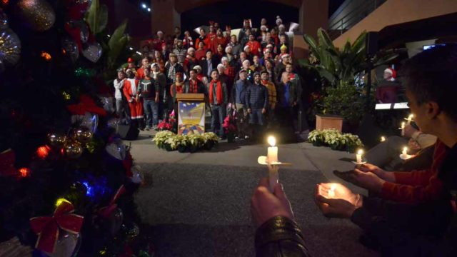 About 300 people gathered in Hillcrest on World AIDS Day to remember those who have died and note progress that has been made. Photo by Chris Stone