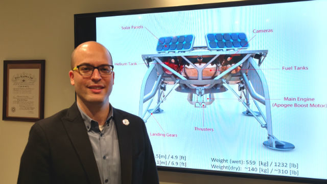 Yonatan Winetraub with a diagram of the SpaceIL moon lander. Photo by Chris Jennewein