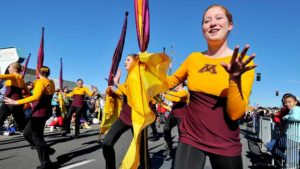 Color guard members of the Golden Gophers Marching Band prance for crowd between music routines. Photo by Ken Stone