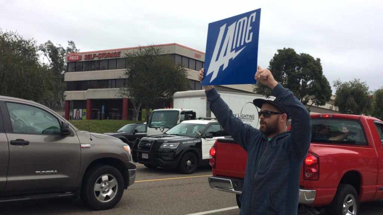 "A Chargers fan changes the new logo into a ""Lame"" sign. Photo by Chris Stone"