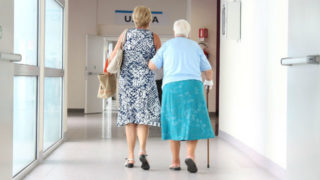 Assisting an elderly woman